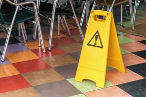 old wet and damaged commercial restaurant floor coverings