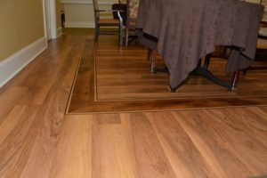 senior home renovation upgraded decorative inlay hardwood flooring