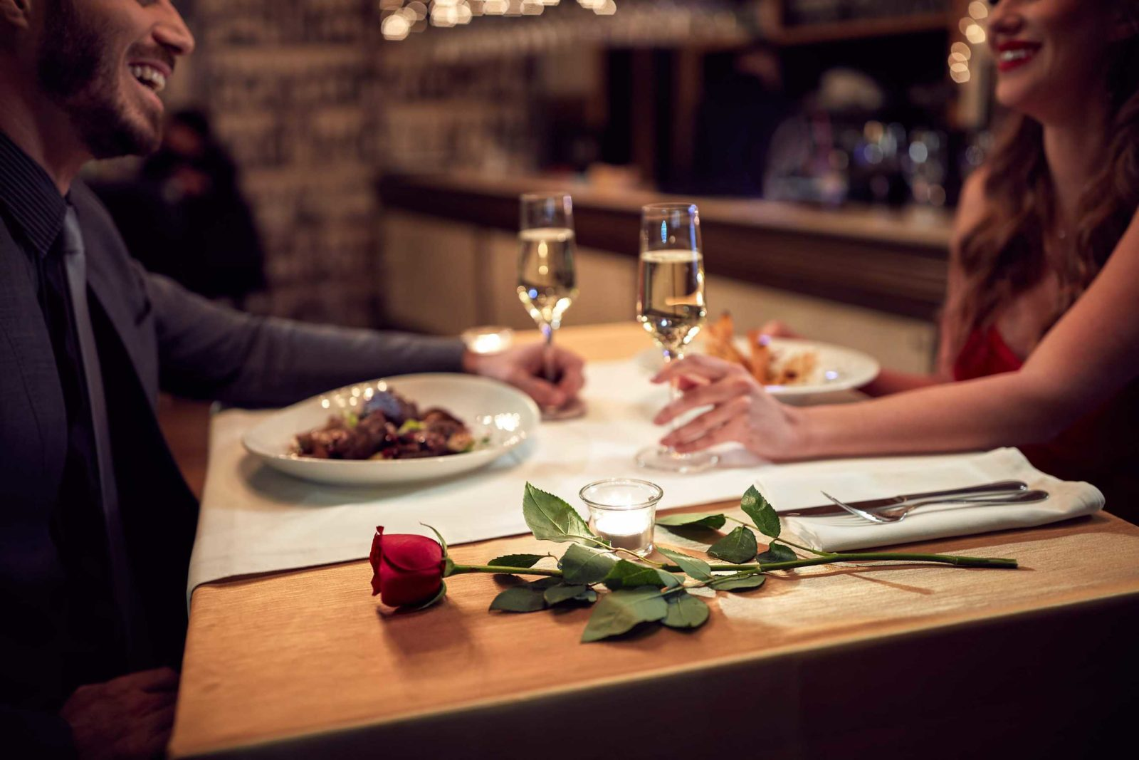 mep restaurant remodeling companies provide ambiance restaurant wall coverings for anniversary couple with wine and a rose