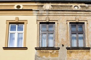 old hotel restoration window replacement and new stucco