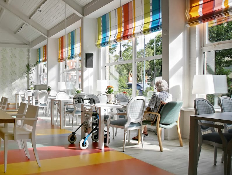 bright open colorful dining area in senior home renovation