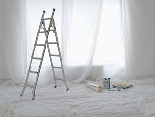 ladder and drop cloth in hotel renovation projects with white paint colors for walls