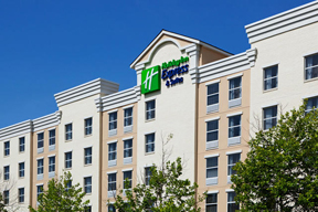 exterior view of mep construction at holiday inn express hotel