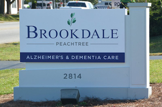 nursing home construction with brookdale care sign