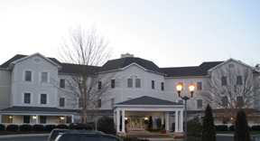 senior living construction large building with circle drive entry