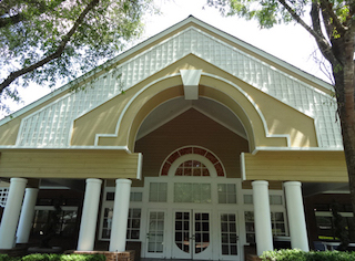 senior living construction multi column entry way with arched glass